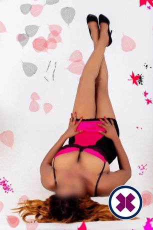 Busty Naomi is a sexy Caribbean Escort in Wrexham